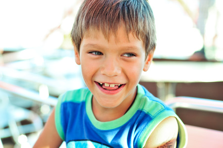 scallywag: happy and laughing funny little boy outdoors Stock Photo