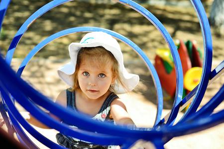 on playground: happy child having fun on the playground