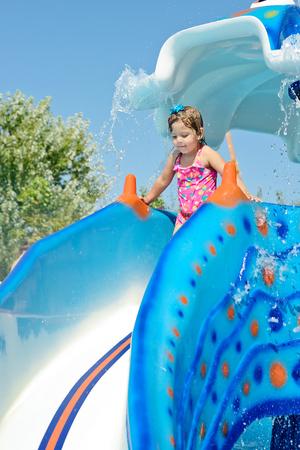 aqua park: cute toddler girl in the aqua park