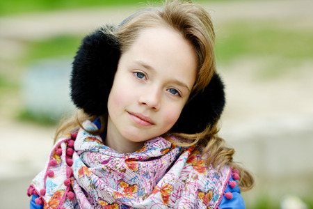 preteen model: portrait of blonde girl outdoors in spring time Stock Photo