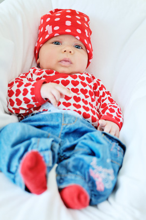 two months: cutie two months old fashion baby in jeans Stock Photo