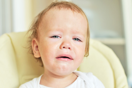 tearful: tears of baby girl at the home Stock Photo