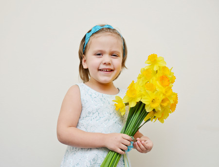 3 persons only: happy  and laughing toddler girl with flowers