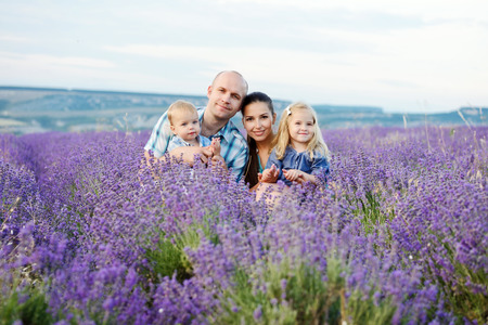 baby hand: happy family with two kids in lavender field