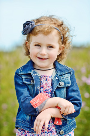 a cute and fashion toddler girl outdoors photo