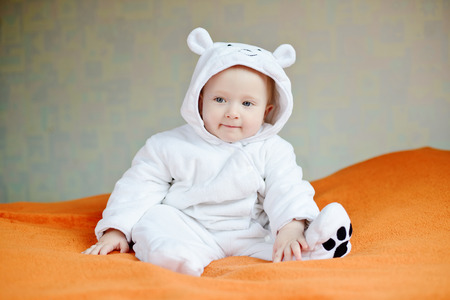 baby boy: funny smiling baby wearing costume of polar bear