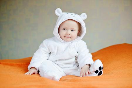 good boy: funny smiling baby wearing costume of polar bear