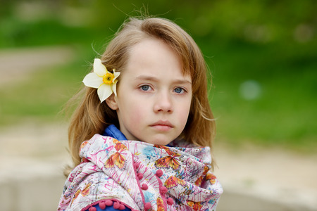 preadolescence: portrait of blonde girl outdoors in spring time Stock Photo