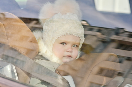 buckled: baby in the car in car seat in winter time