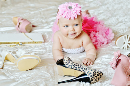 bed skirt: fashion baby girl laying on the bed with high heels shoes and bags