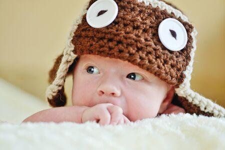 newborn: cute little newborn baby wearing funny hat