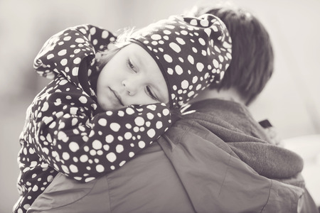 father and child: a little daughter on the  father shoulder Stock Photo