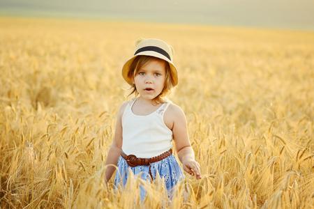 prety: prety little girl in the wheat field
