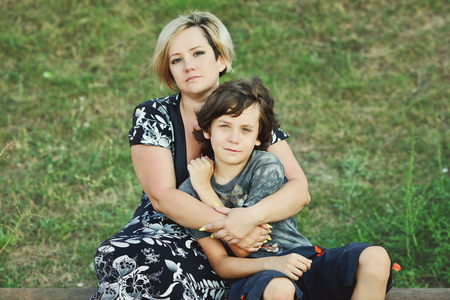 nephew: middle age woman and her son outdoors