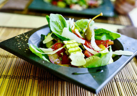 ingridients: salad with parmesan cheese and other ingridients