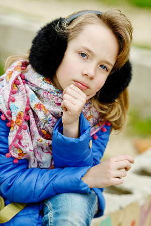 earmuff: portrait of blonde girl outdoors in spring time Stock Photo