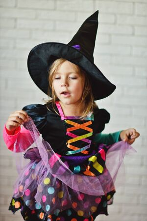 antichrist: Portrait of girl wearing witch costume posing before camera Stock Photo
