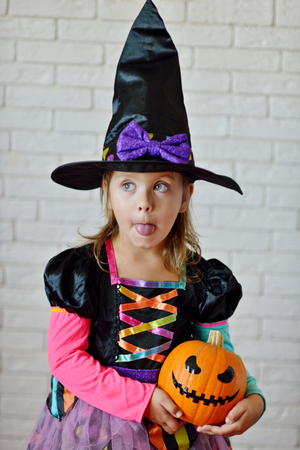 haunt: Portrait of girl wearing witch costume posing before camera Stock Photo