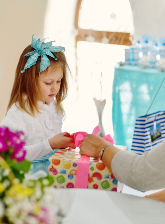 guests: sweet birthday girl getting present from guests