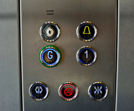 pannel: seven different  elevators bottoms on the pannel Stock Photo