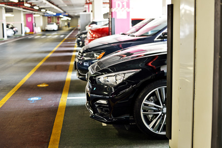 Underground parking zone, full of  the cars Stock Photo