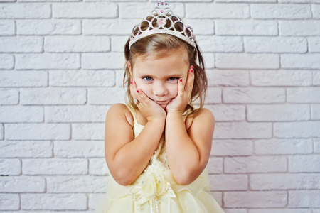 pretty little girl: sweet princess girl with crown and red nail Stock Photo