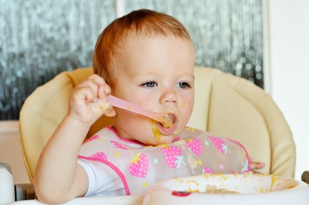 durty: eating baby girl with spoon and durty face
