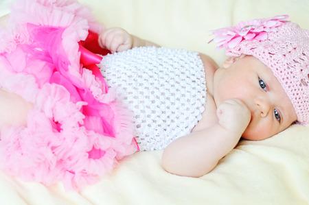 tutu: sweet newborn girl is wearing tutu skirt