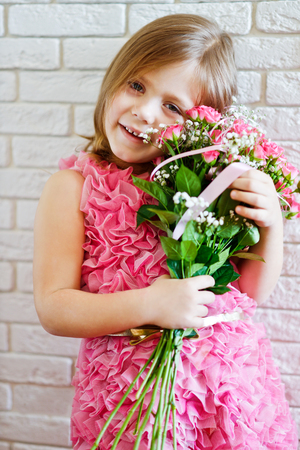 happy fashion sweet little girl with flowers