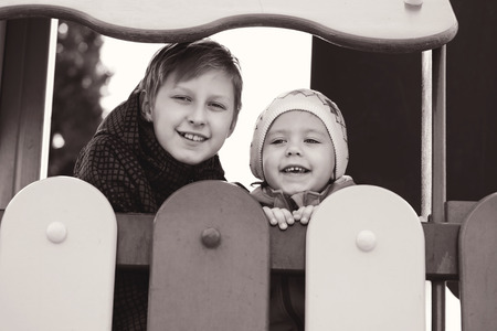 happy brother and sister on the playground photo