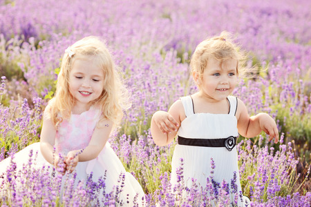two happy girls in field of lavender photo
