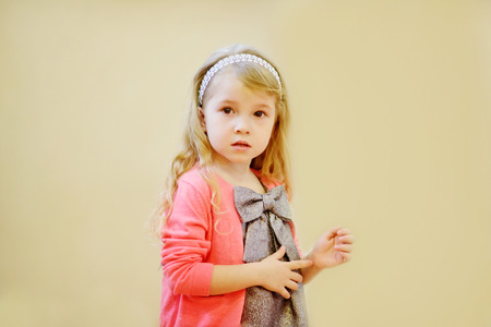 sweet pretty little girl wearing beautiful dress photo