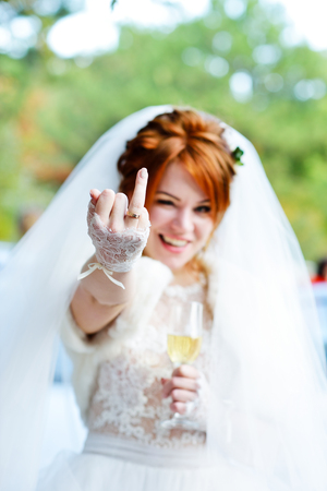 funny redhead bride showing her  wedding ring