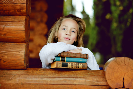 portrait of sweet and pretty  girl with books photo