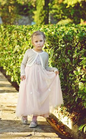little sweet girl wearing beautiful long dress photo