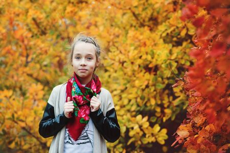 Happy sweet preteen girl in autumn forest Stock Photo