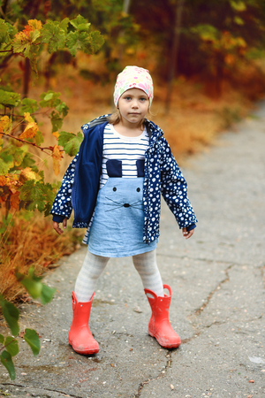 sweet and funny girl in fall time photo