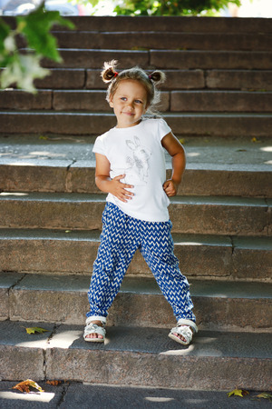 fashion little girl on the walk in summer photo