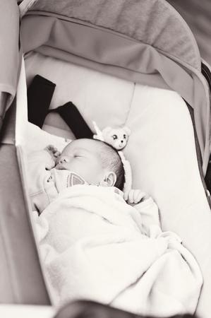 newborn baby is sleeping in the pram photo