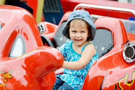 girl in car in the theme park photo