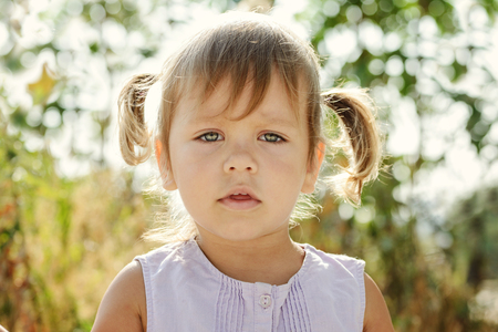 Portrait of toddler girl with ponytail hairstyle
