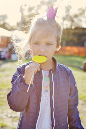 girl on the street fayre eating gingerbread  Stock fotó