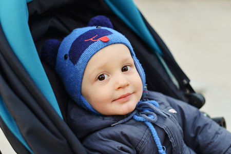 baby boy in stroller in cold time
