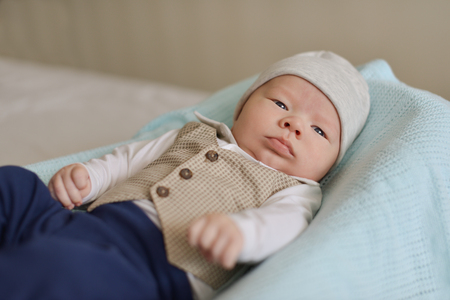 newborn tiny gentleman wearing little shirt and vest