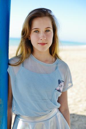 summer teen girl standing on the beach