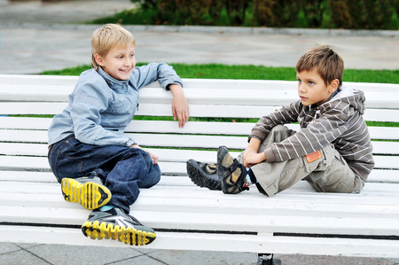Boys are sitting on the bench   and talking 写真素材