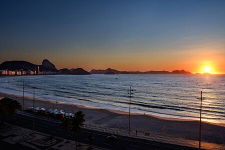 sunrise over the Atlantic ocean and Copacabana beach, Rio de Janeiro, Brazil