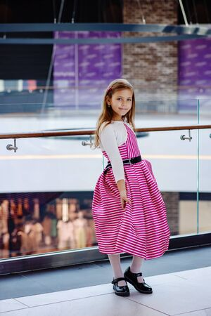 pretty little girl wearing fashion striped dress
