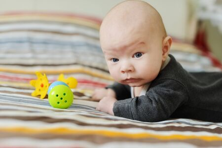 funny baby boy  with toys at home