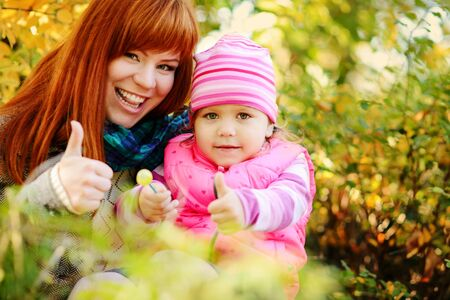 two happy cosines in fall with thumbs up Archivio Fotografico